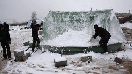 Syrische vluchtelingen in de sneeuw